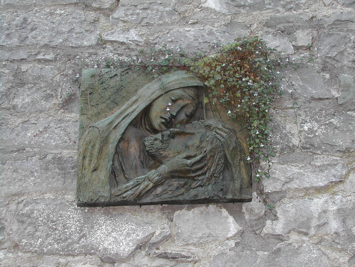 Wall detail of church in Ireland. Jesus and Mary photo