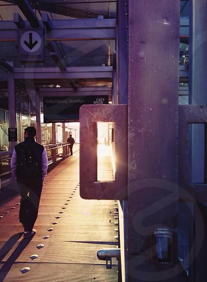 man walking on bridge photo