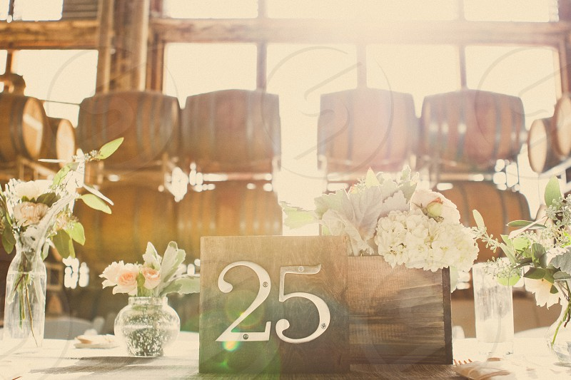brown hardwood table number card with silver number 25 photo