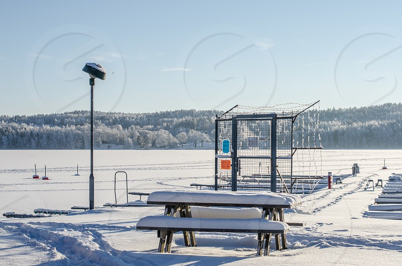 bench and field under snow photo