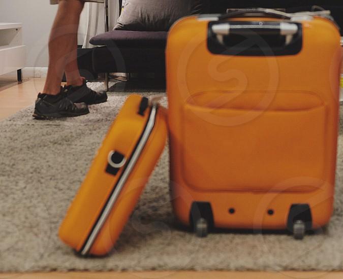 orange travel luggage photo