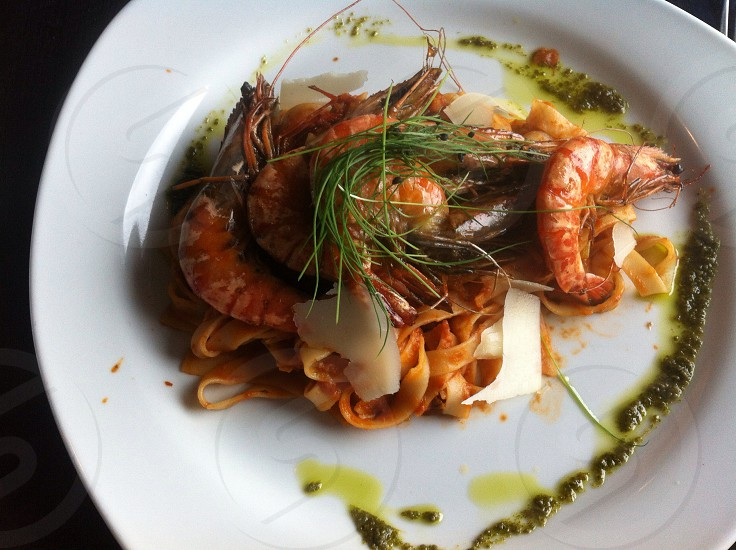 King prawn with tagliatelle with a basil dressing.   photo