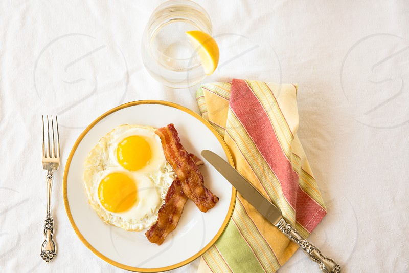 sunny side up eggs with bacon photo