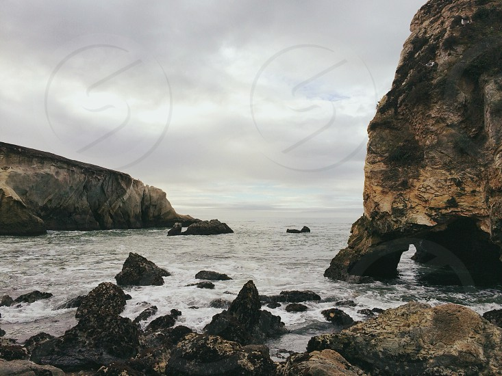 rock formation on beach photo