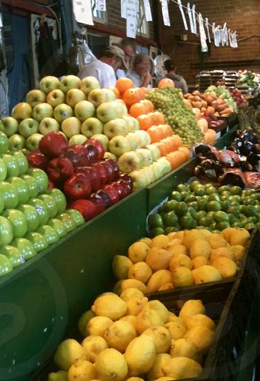 Soulard Farmers Market Saint Louis Missouri fresh fruit red green apples lemons limes oranges vendors photo