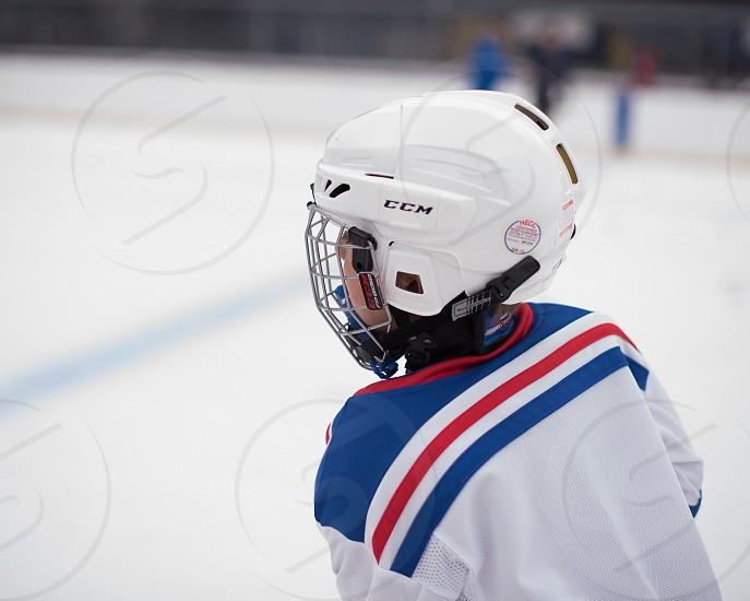 Hockey practice on ice ice skating helmet to protect  photo