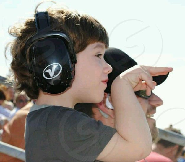 Father taking young son to his 1st NASCAR race in Daytona for the Daytona 500 photo