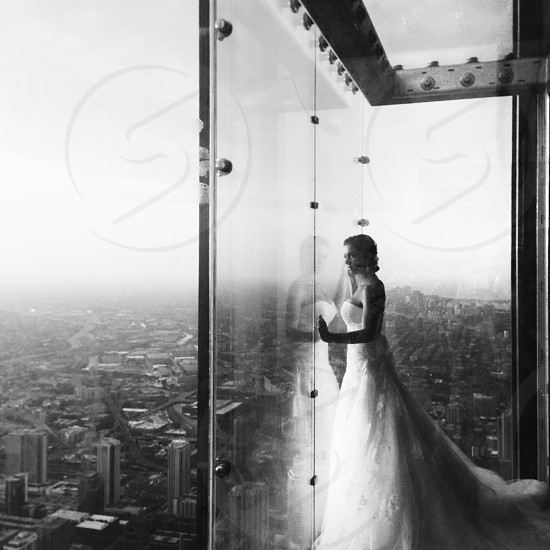 black and white photo of a woman wearing a wedding dress photo