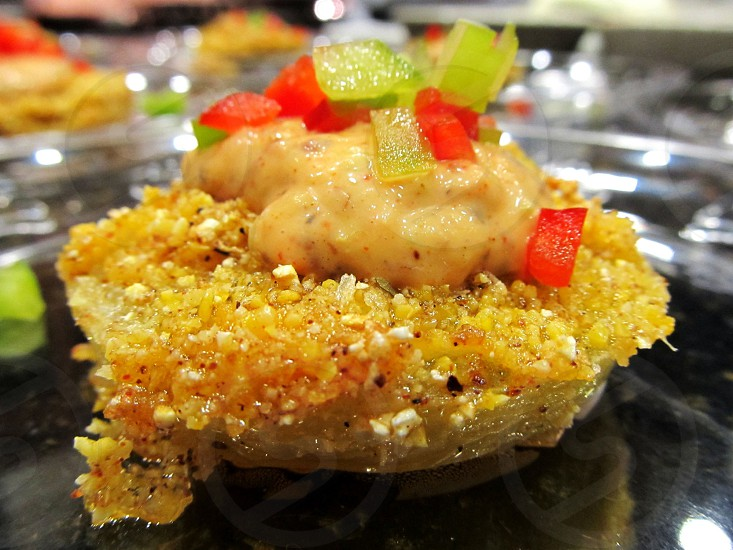 Baked green tomatoes with grits batter topped with peppers and remoulade sauce photo