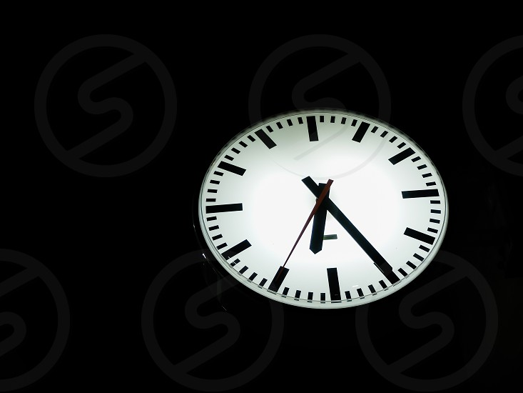 White clock with black background Rush hour morning photo
