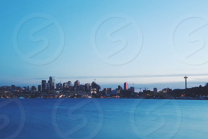 body of water and cityscape under blue sky photo