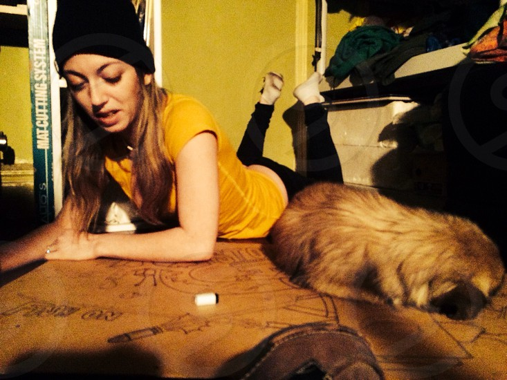This photo was taken by my husband of me painting on the floor with my friends dog in a Brooklyn apartment. photo