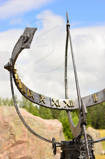 A sundial in a stone park photo