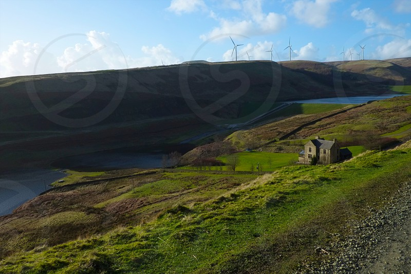 House under the windy hill by the reservoir. photo