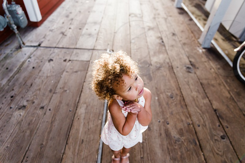 child with white dress photo