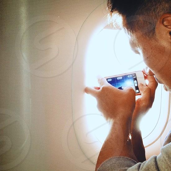 man using white iphone photo