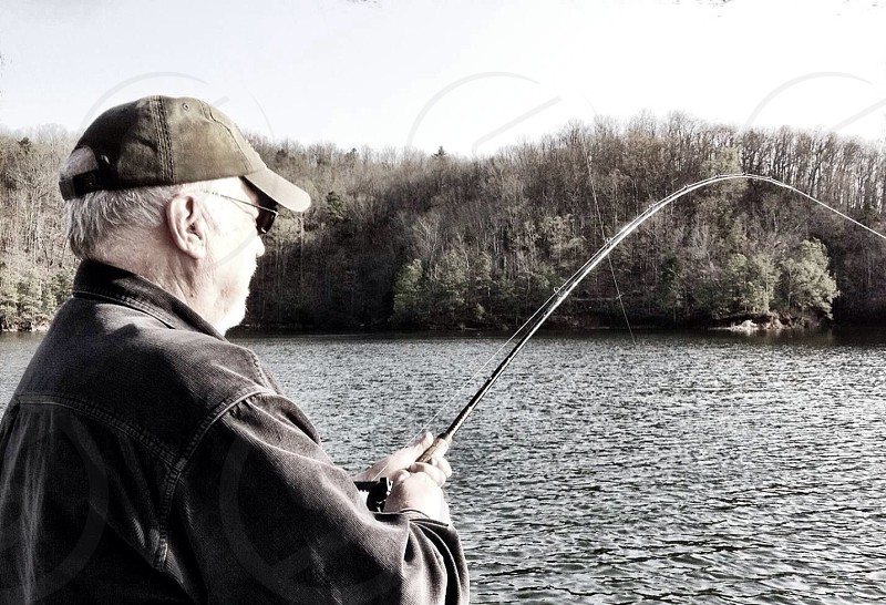 man fishing gray scale people photography photo