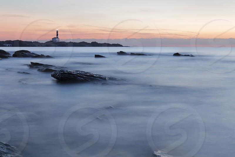 lighthouse landscape sunrise photo