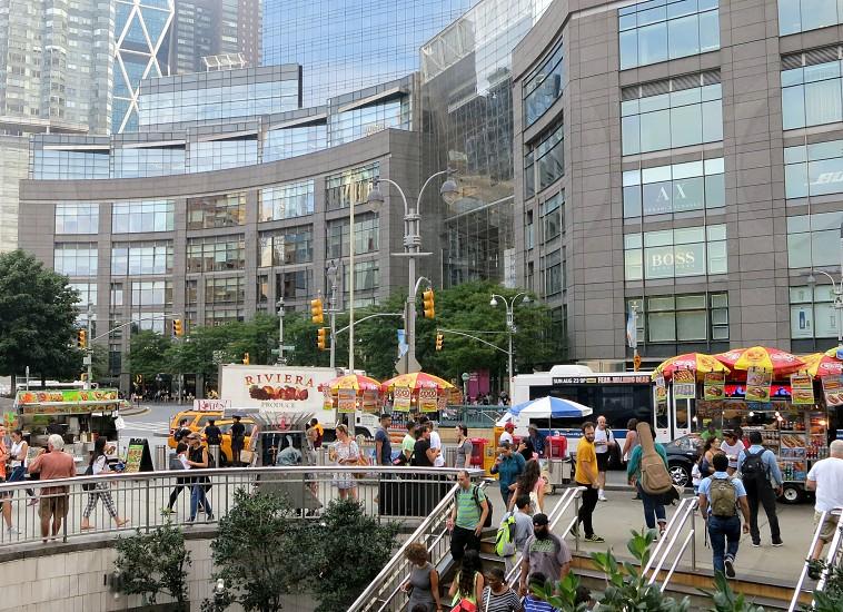 Busy street scene at Columbus Circle subway station New York City photo