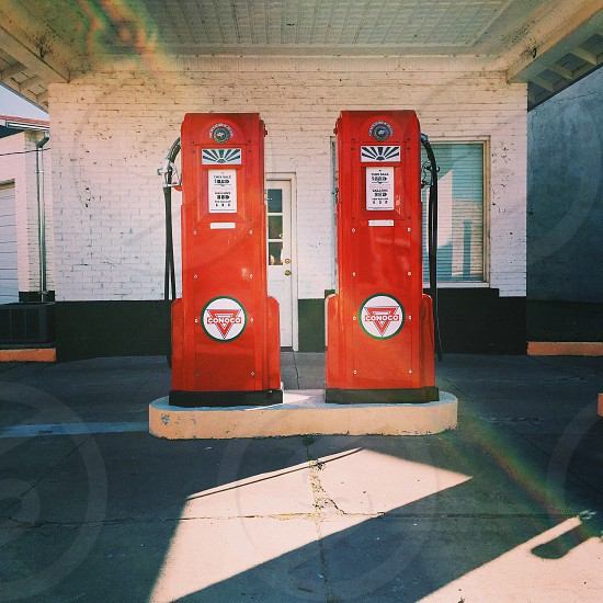 2 red white and black gas pumps photo