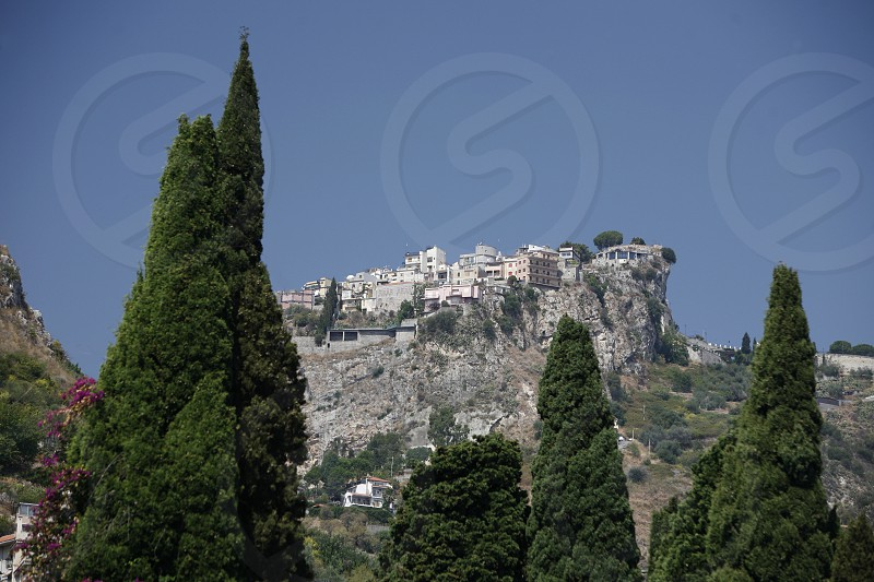 The mountain Village of  Castelmola over the old Town of  Taormina in Sicily in south Italy in Europe. photo