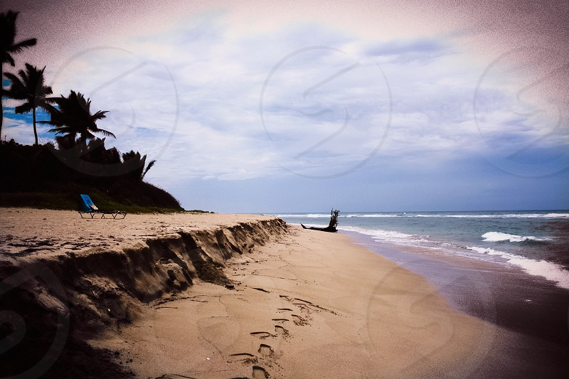 Footprints on the beach. photo