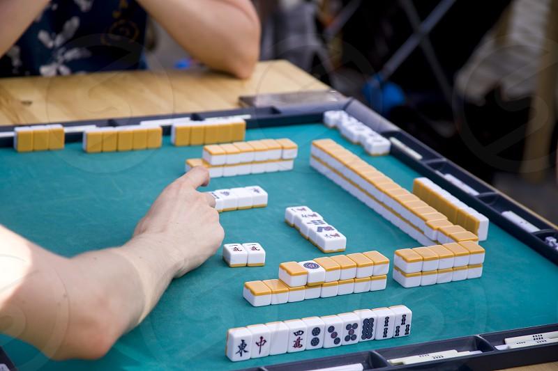 Playing the national Japanese Mahjong table game  photo