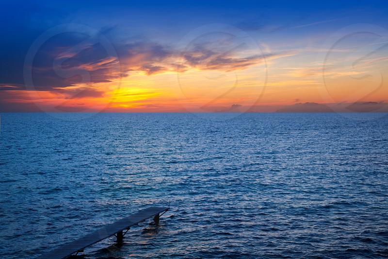 Balearic Formentera island sunset in Mediterranean seascape with warm lights photo