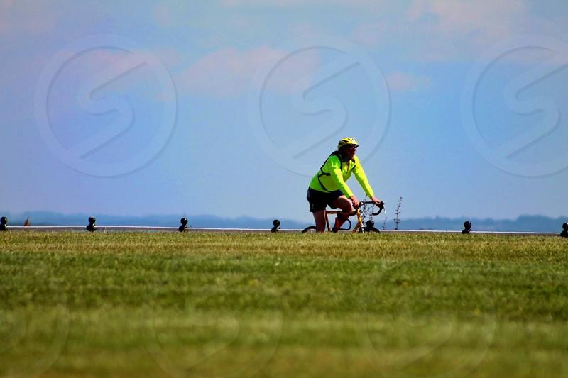 Negative spacegrassseaskycyclistsummersday photo