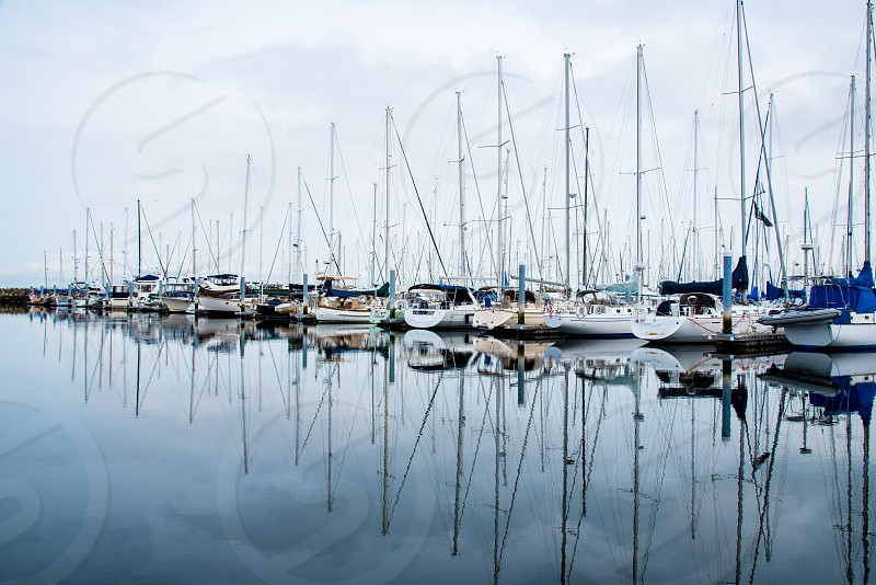 Marina harbor boats reflection water Seattle Washington dock sailing sailboat photo
