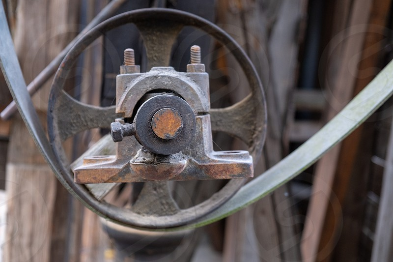 an old and rusty belt drive from an old machine photo