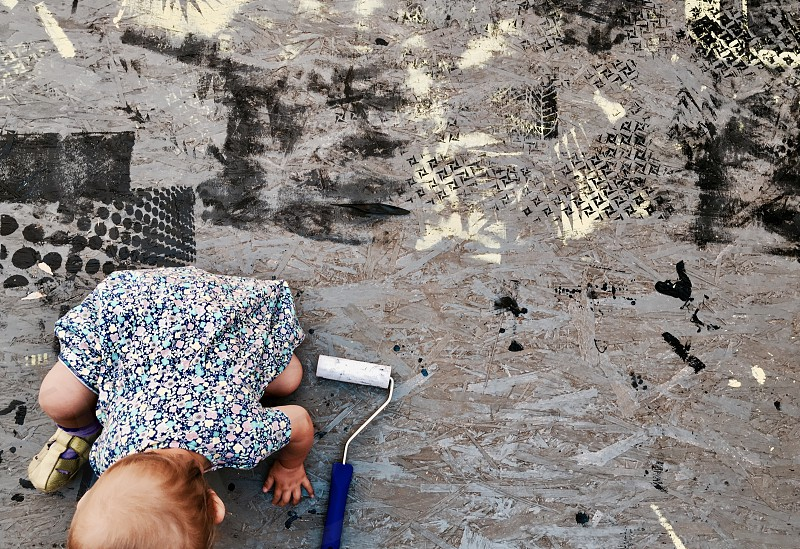 baby infant girl paint painting play playing back grey colors creative photo