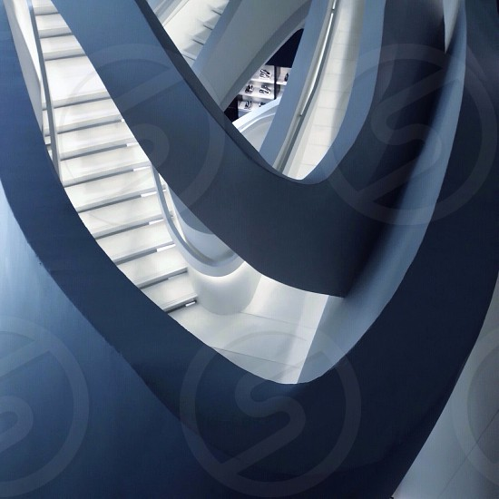 spiral staircase with white handrails photo