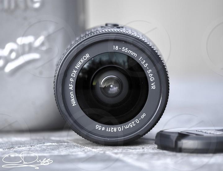 A monochrome long exposure photo of a camera lens photo