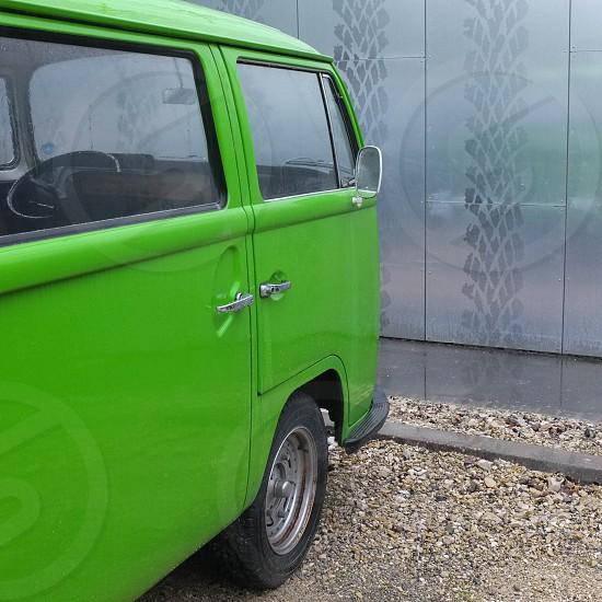 vw transporter green reflection rain tire marks wall photo
