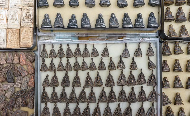 Buddhist amulets for sale in Bangkok Thailand. photo