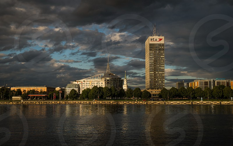 Panorama View of Riga city from the riverside at dawn photo