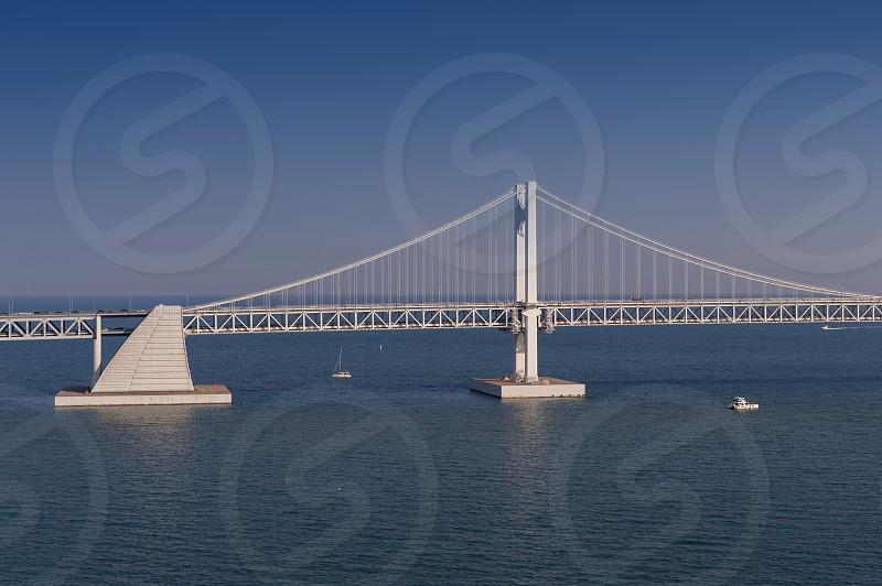 Scenic view of Busan Gwangandaegyo Bridge (Diamond Bridge) a suspension bridge connecting Haeundae-gu to Suyeong-gu in Busan South Korea photo