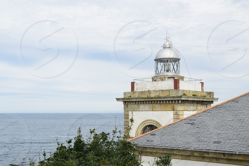 Lighthouse. Religion seascape light sky sea religion loving caring  photo
