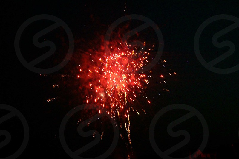 red fireworks during night photo