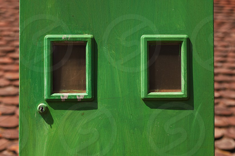 Details of a green electricity meters box household equipment.  photo