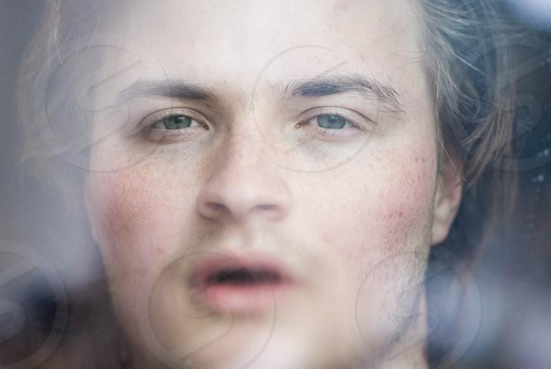 man's face photo