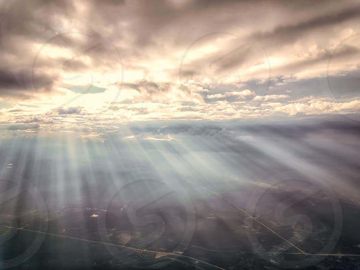 sunlit streaming through clouds photo