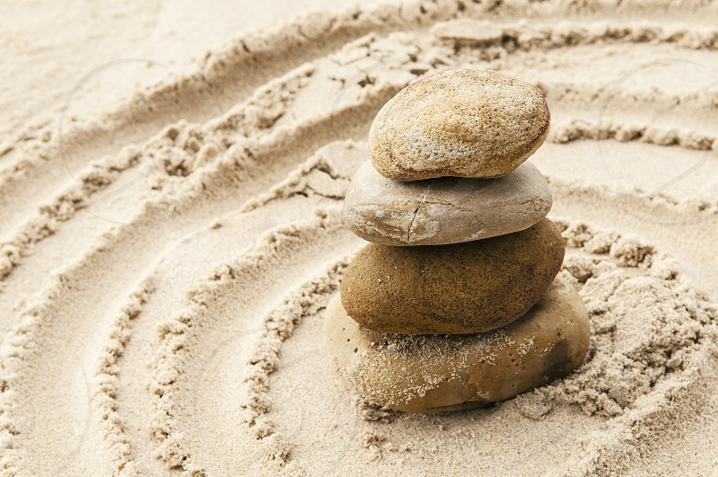Balancing of stones on sand. photo