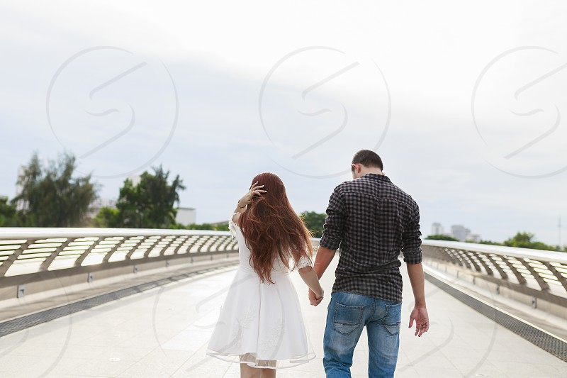 Couple hand in hand photo