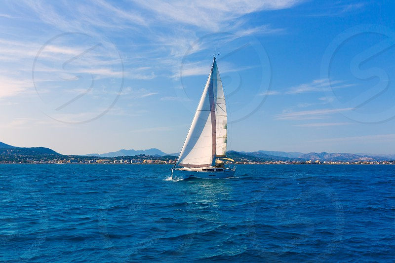 Javea sailboat sailing in Xabia at Mediterranean Alicante of Spain photo