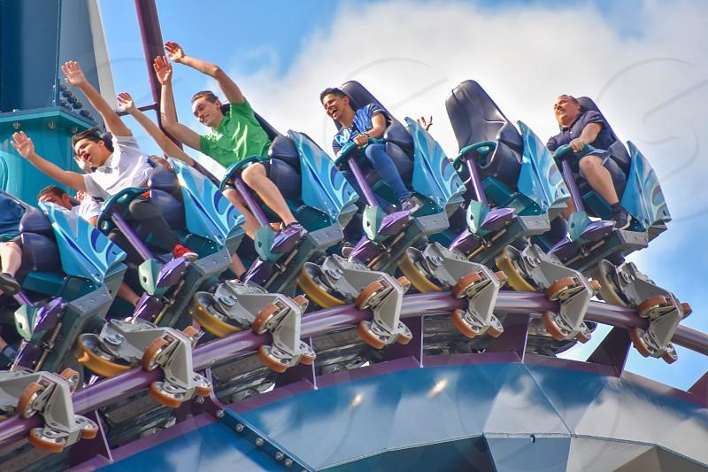 Orlando Florida . February 17  2019. People having fun Mako Rollercoaster on lightblue cloudy sky bakcground at Seaworld   (10) photo