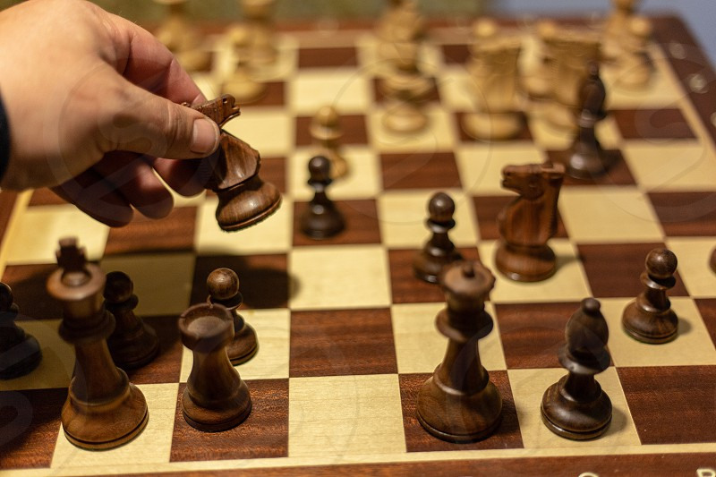 pov point of view chess board games pieces wood squares king queen rook knight bishop pawn brown colors maple walnut play checkers move photo