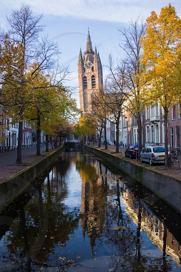 Netherlands delft church water reflection street photo