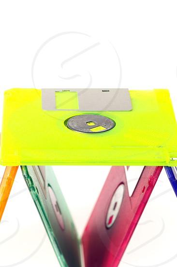 coulorfull plastic floppy disk on white background photo
